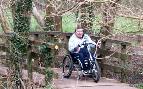 A Clip-on Handcycle being used in Moors Valley