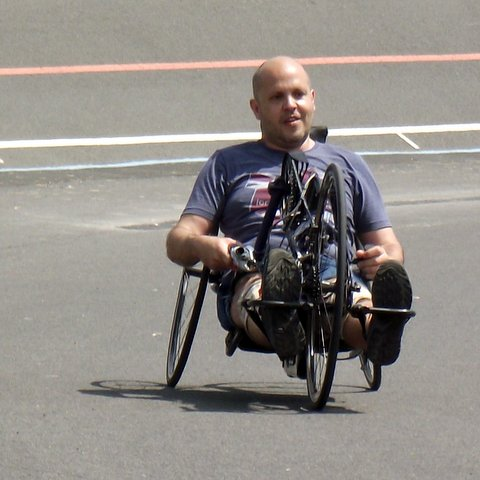 A recumbent handcycle in use