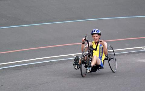 A Recumbent Handcycle in use.
