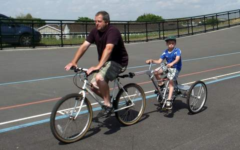 A Father and Son using our Trailer Bike.